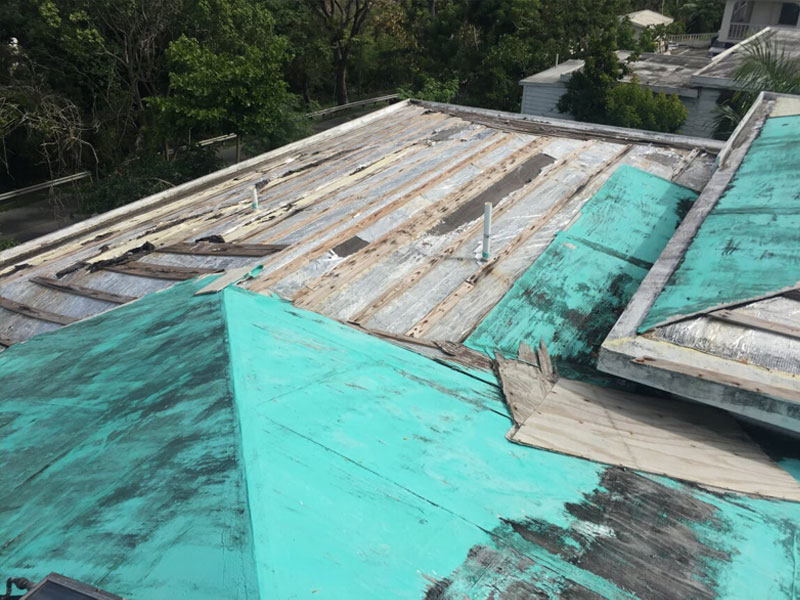 Insurance claim settlement with public adjuster for roof damage