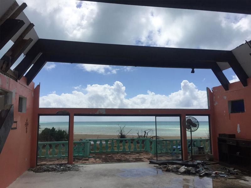 Hurricane damaged roof of vacation property insurance claim