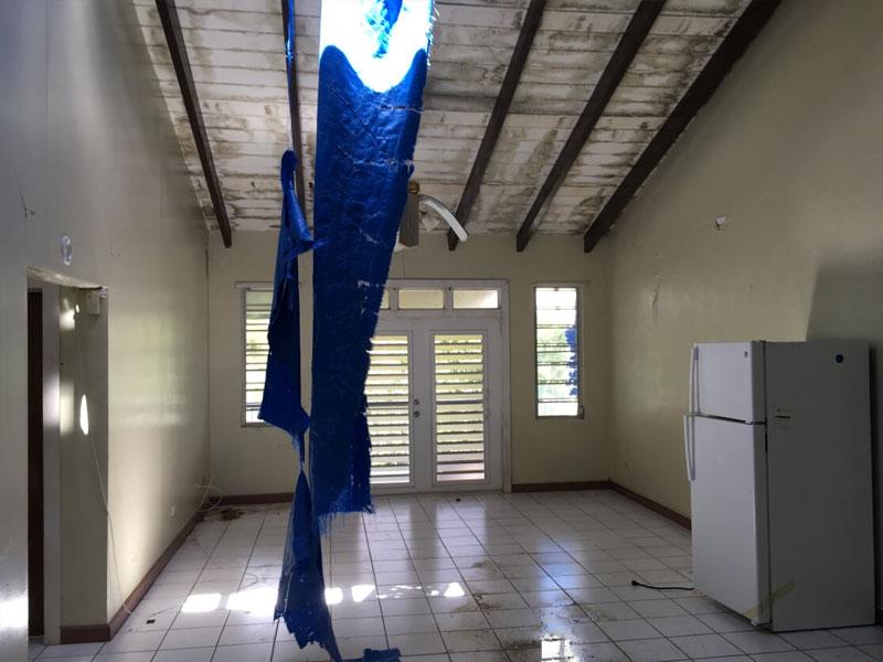 Roof damage insurance claim from hurricane settled