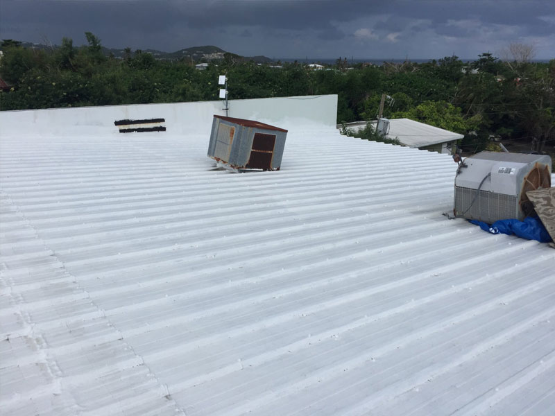 Storm damage on roof of commercial building
